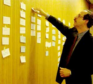 During a brainstorming session, Jonathan Lehrer organizes ideas.
