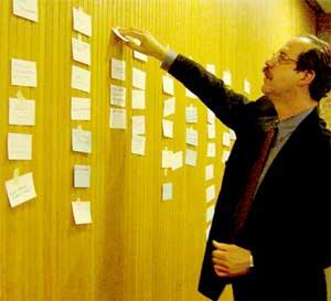 During a brainstorming session, Jonathan Lehrer organizes ideas.